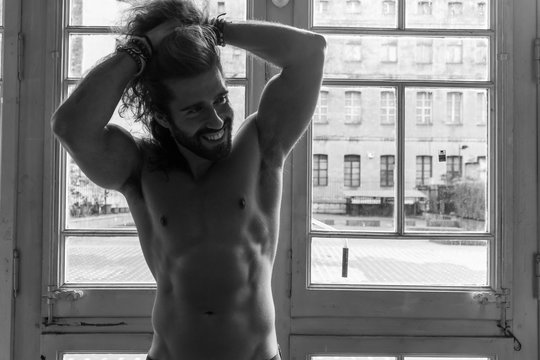 Man with long hair showing his body