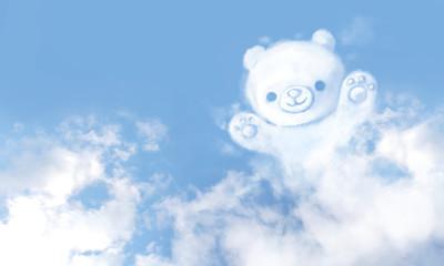 Teddy bear-shaped clouds on blue sky background.
