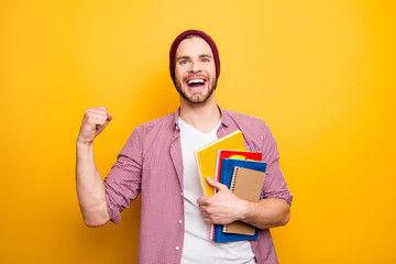 Hold hands learn checkered shirt youth style trend stylish people concept. Portrait of handsome excited surprised amazed astonished student with book in hands raising fist up isolated background
