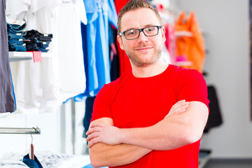 Man picking clothes in shop or store