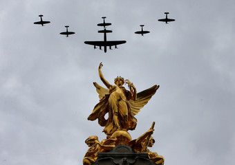 Military aircraft perform a fly past over Buckingham Palace to mark the centenary of the Royal Air Force in central London