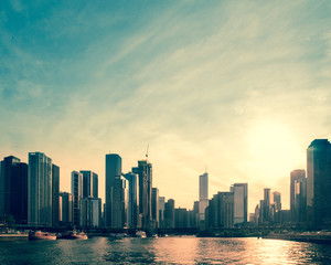 Downtown Chicago skyline at sunset with buildings and Lake Michigan