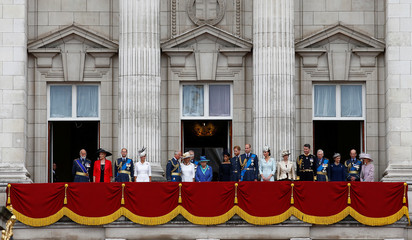 Britain's Queen Elizabeth is joined by members of the Royal Family on the balcony of Buckingham Palace as they watch a fly past to mark the centenary of the Royal Air Force in central London