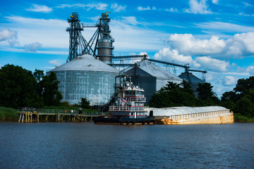 Tugboat and Barge on the Rappahannock River at The Tappahannock Grain Facility