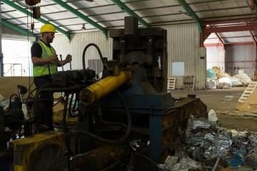 Worker operating a machine in the scrapyard
