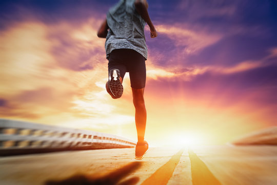 Athletes are running on the street with morning sunshine.