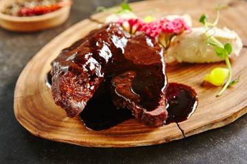 Roasted Mutton on Rustic Wooden Background