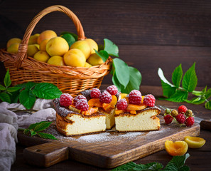 curd pie with raspberries and apricots