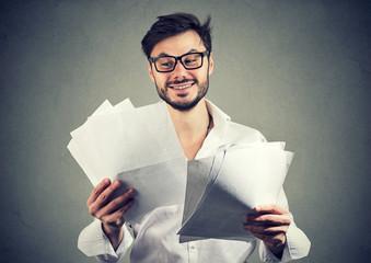 Cheerful beard man reading papers