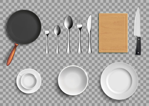 Set of ceramic plates and kitchen utensils.