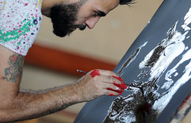 Egyptian speed painter Albert Magdy is seen while painting inverted portrait of American actor Will Smith in Cairo
