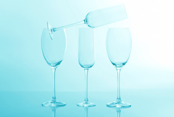 four empty wine glass on a light blue background