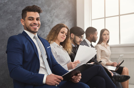 Multiracial people waiting in queue preparing for job interview