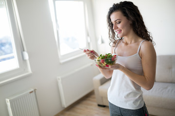 Fitness woman eating healthy food after workout