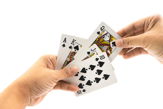 Hand of man is holding spade straigt flush isolated
