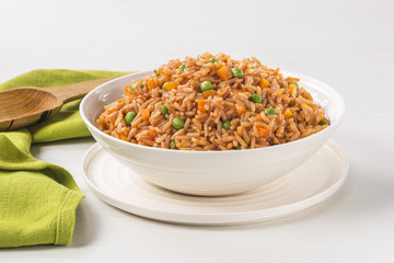 """Mexican red rice plate Very famous Mexican rice dish called """"Arroz a la Mexicana"""""""