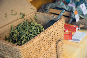 Wicker chest full of dried herbs in French open air market