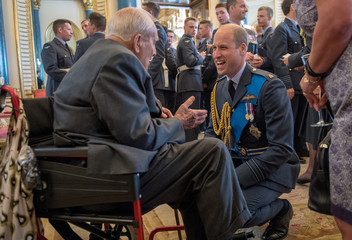 Britain's Prince William speaks to Jock Heatherill, 95, wing commander of 158th squadron, Halifax's, at a reception to mark the centenary of the RAF at Buckingham Palace