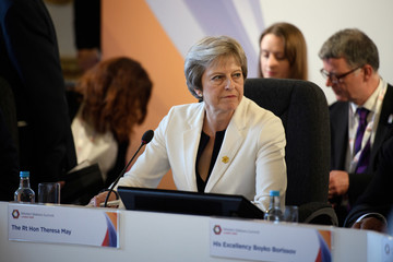 Britain's Prime Minister Theresa May leads a plenary session during the Western Balkans Summit 2018 at Lancaster House in London