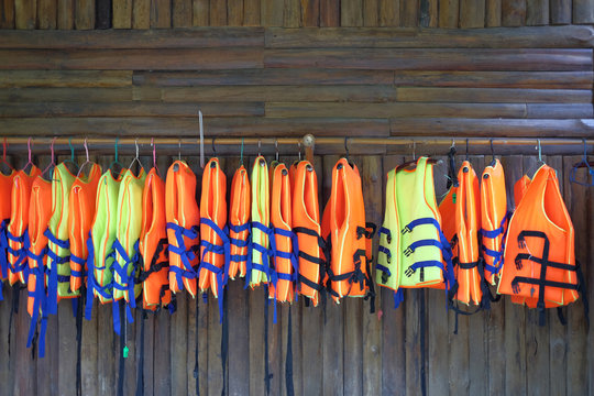 row of  life jacket hanging for tourist services.