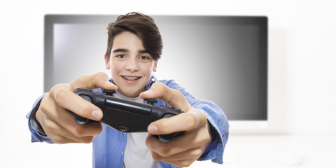 young man playing with the joystick of video games