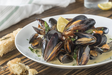 Mussels cooked with lemon and white wine.  Seafood plate specialty of both France and Belgium