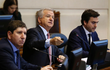 Chile's Finance Minister Felipe Larrain(C), speaks during the meeting of the Finance Commission at the Congress in Valparaiso