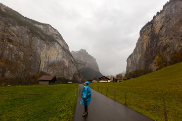 girl on a rural road in switzerland near the mountain jungfrau