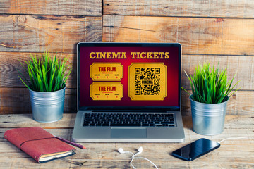 Online cinema tickets purchase in a laptop screen, at the office.