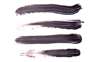 Set of Black strokes of mascara on a white background. Texture of black mascara for eyelashes isolatedon white. Smear of black mascara for eyelashes. Black mascara or paint smears