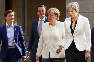 German Chancellor Angela Merkel walks with Britain's Prime Minister Theresa May during the Western Balkans Summit 2018 at Lancaster House in London
