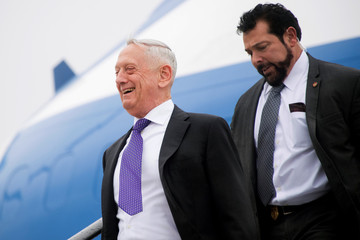 U.S. Secretary of Defence James Mattis disembarks from an aircraft in Brussels