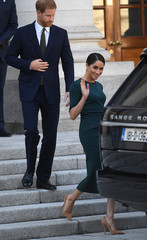Britain's Prince Harry and his wife Meghan, the Duke and Duchess of Sussex, leave after visiting the Taoiseach Leo Varadkar, at the start of a two-day visit to Dublin
