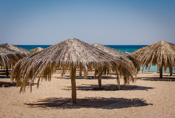 Beach umbrellas on the beach of the Red Sea in Egypt