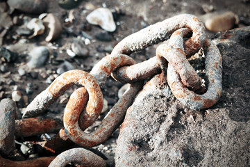 Rusty chain on a rock