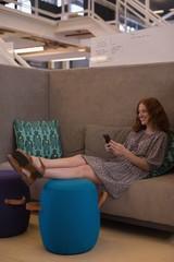 Beautiful female executive using mobile phone