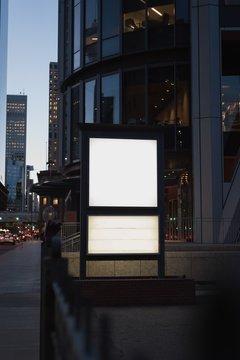 Blank advertisement board near street
