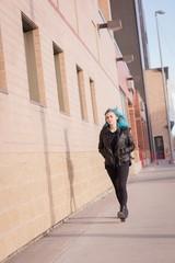 Woman walking on city street