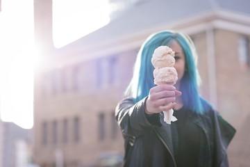 Stylish woman holding an ice cream