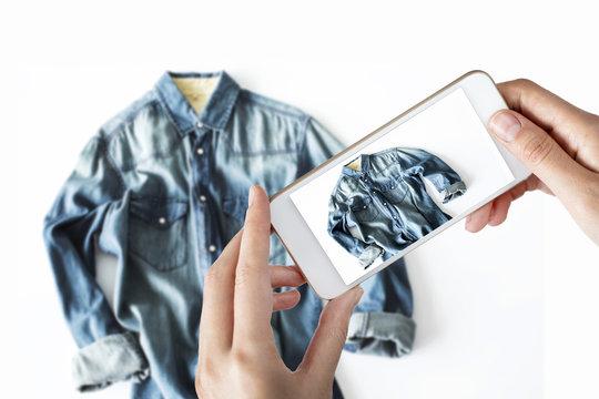 Woman taking a photo of a jean shirt