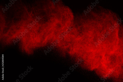 Abstract red powder splatted background,Freeze motion of