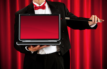 Magician: Holding a Blank Laptop