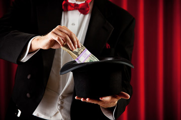 Magician: Pulling Cash Out of Magic Hat