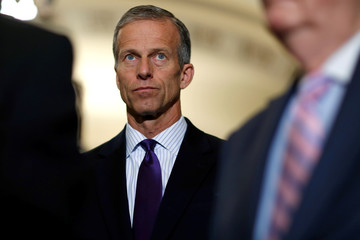 Senator John Thune (R-SD) stands after the Republican policy lunch on Capitol Hill in Washington