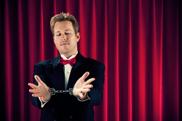 Magician: Man Must Escape From Handcuffs
