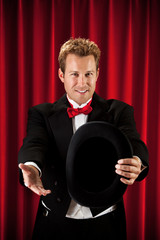 Magician: Showing Empty Hat to Audience