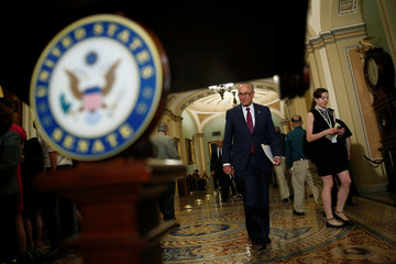 Senate Minority Leader Charles Schumer (D-NY) walks after the Democratic policy lunch on Capitol Hill in Washington