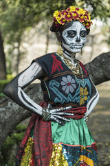 Elegant but sad skeleton woman Death character fully dressed and painted Catrina