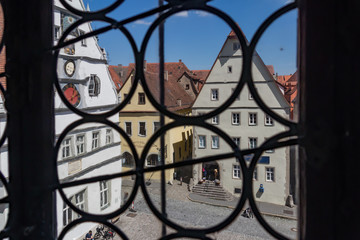 Aerial view of historic cityscape, Rothenburg ob der Tauber, thru a tower window