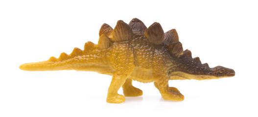 Toy plastic Kentrosaurus isolated on white background.